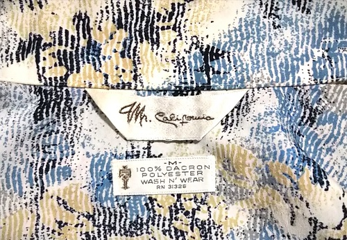 Tag of 70s dacron polyester shirt .