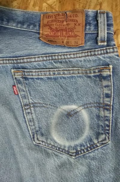 Round fades in jeans pockets.